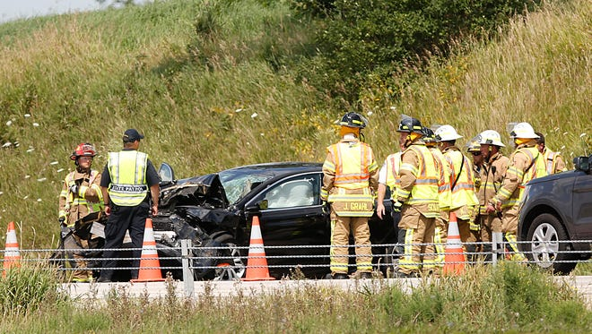 Emergency officials work the scene of a crash Tuesday on Interstate 41 just north of Fond du Lac County B.