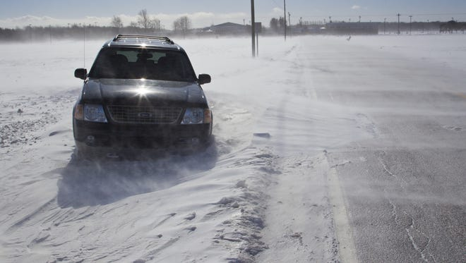 An abandoned SUV sits along Tippecanoe County Road 750 East. Some roads were impassable, particularly where snow collected in low spots, said Darryl Sanders, Clinton County emergency management director.