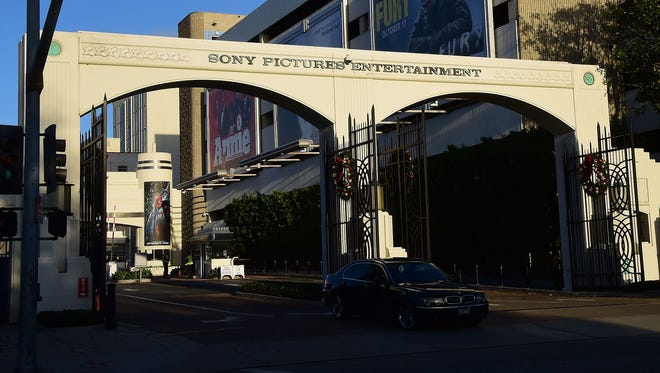 "A vehicle exits Sony Pictures Entertainment in Los Angeles on Thursday, Dec. 4, 2014, a day after Sony Pictures denounced a ""brazen"" cyber attack it said netted a ""large amount"" of confidential information, including movies as well as personnel and business files."