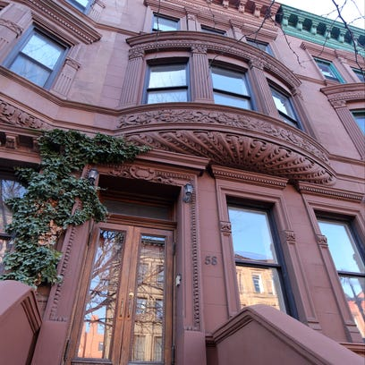 Poet Maya Angelou lived in a Harlem brownstone on W. 120th Street, which is on the market.