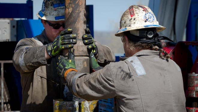 Workers change pipes at Consol Energy Horizontal Gas Drilling Rig exploring the Marcellus Shale outside the town of Waynesburg, Pa. in 2012.