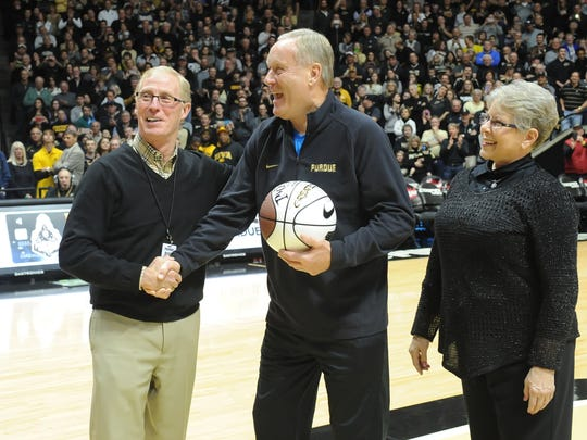 Rick Mount and his wife Donna are greeted by Athletic Director Morgan Burke Saturday night.