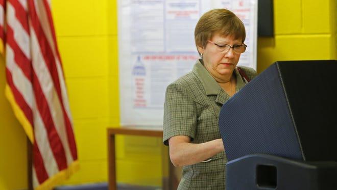 Debbie Ecklar casts her vote at John G. Carlisle Elementary School in Covington.