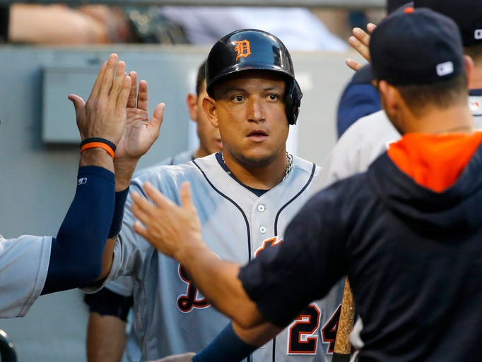 Detroit Tigers' Miguel Cabrera celebrates in the dugout