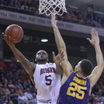 Auburn's Cinmeon Bowers goes to the basket against LSU forward Ben Simmons on Feb. 2 in Auburn, Ala.