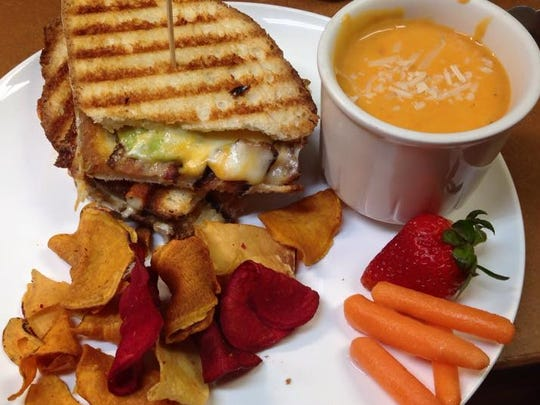 Gourmet grilled cheese on Italian: three cheeses, roasted tomatoes, avocado and bacon. Served with a cup of soup and chips for $8.50.