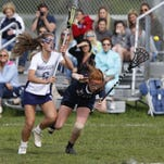Bella Feldman (6) of Manasquan and Shannon Nichols (27) of Wall Twp. collide going after the ball during SCT girls lacrosse game at Sea Girt Army Camp, Seagirt,NJ. Wednesday, May 11, 2016. Noah K. Murray-Correspondent/Asbury Park Press