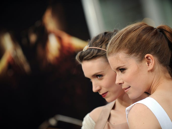 Actresses Rooney Mara (L) and Kate Mara (R) arrive