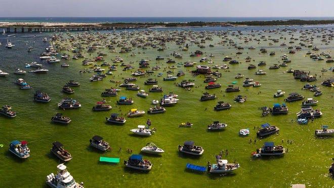 Boats crowd around Crab Island