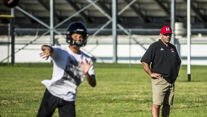 New Metamora high school football coach Jared Grebner watches his team practice earlier this week. Under an Illinois High School Association plan, football is to be contested in the 2021 spring semester instead of the 2020 fall semester, because of COVID-19.