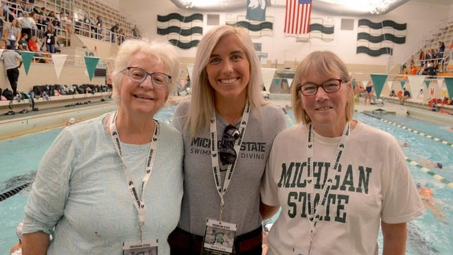 Jennifer Parks (left), Shelby Lacy and Jane Meyers stand together at the Michigan State swimming 50th anniversary meet last year.