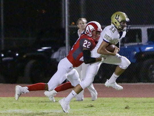 Danny Valdez catches the ball on the left side of the field. The Desert Mirage varsity football team won Friday's home conference game against Desert Hot Springs by a score of 35-27.