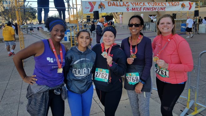 Candice Tyson, far left, of Desoto, Texas, is a mom and run club instructor. She says a breathing exercise helps keep her zen.