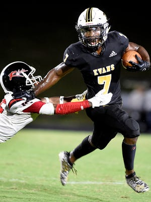 Evans' Jofranstar Graham stiff arms Hephzibah's Nigel Davis during football action at Evans High School in Evans, Ga., Friday evening September 11, 2020.
