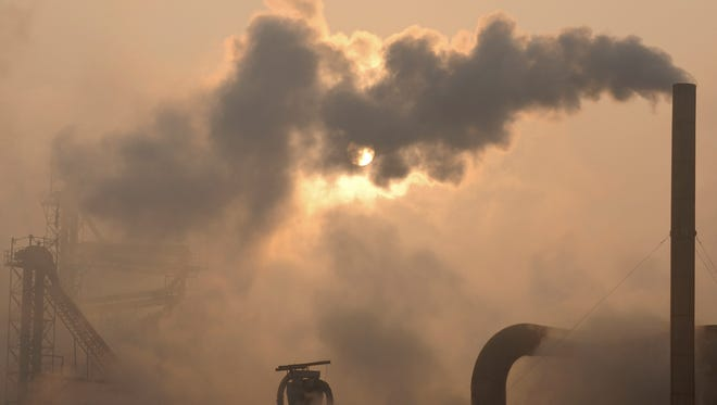 Smoke pours from a chimney at a cement plant in Binzhou, China, on Jan. 17, 2013. Scientists from around the world have gathered in Stockholm for a meeting of a U.N. panel on climate change.