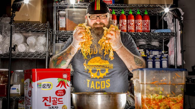 Tacopocalypse owner Sam Auen, shown with his special kimchi in Des Moines, has more restaurants and a cookbook planned.