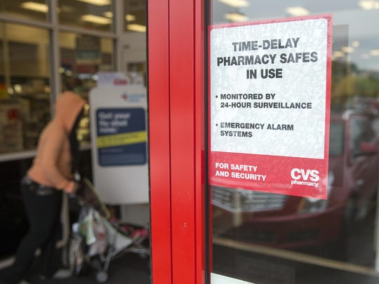 Customers at the CVS drugstore at the corner of Meridian and 16th streets on Indianapolis' Near Northside are now greeted by signs announcing that a time-delay safe system is in use.