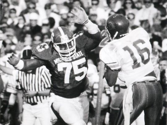 Michigan State defensive tackle Travis Davis (75) puts