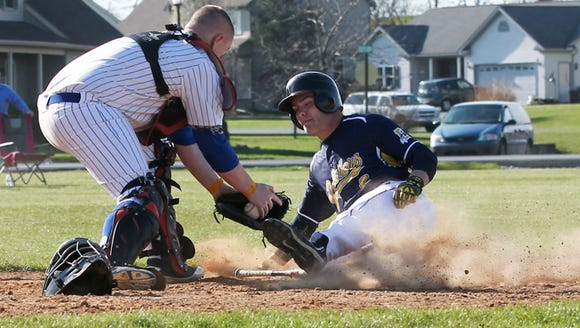 Elco's Nate Hostetter is tagged out at home plate by