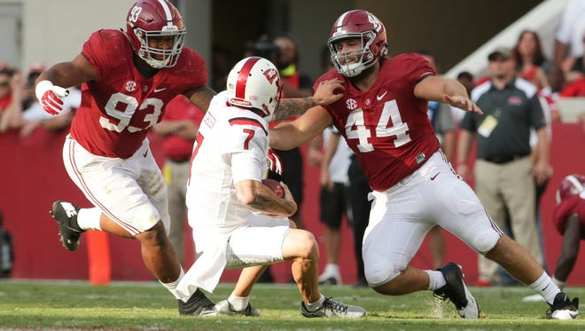 Sep 10, 2016; Tuscaloosa, AL, USA;  Western Kentucky Hilltoppers quarterback Tyler Ferguson (7) tries to get away from Alabama Crimson Tide defensive lineman Dakota Ball (44) and defensive lineman Jonathan Allen (93) at Bryant-Denny Stadium. The Tide defeated the Hilltoppers 38-10. Mandatory Credit: Marvin Gentry-USA TODAY Sports