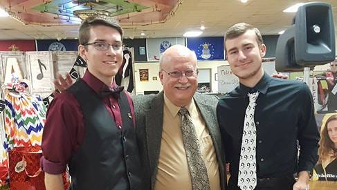 Daniel Cunningham on the left, Mr. Gary Wallyn in the center, and Daniel Gaines on the right.