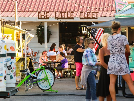Patrons order food from food trucks at The Little Fleet food truck park/bar in downtown Traverse City on Tuesday September 22, 2015.