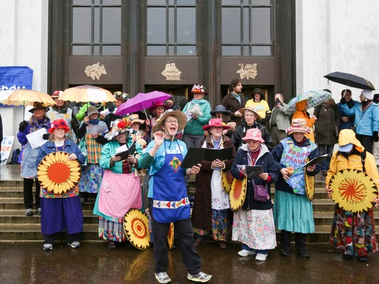 The Raging Grannies perform a song and dance routine at a rally for a Healthy Climate and Clean Energy Jobs on the steps of the Capitol on Wednesday, Feb. 3, 2016.