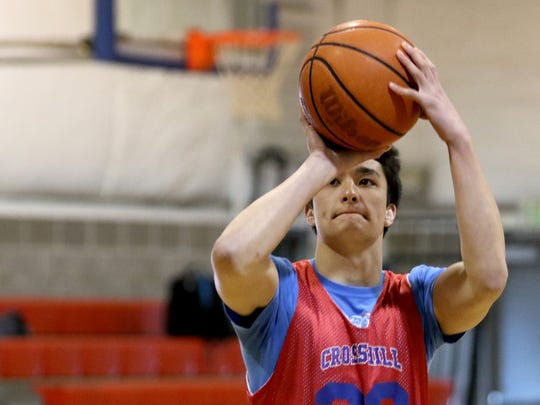 Senior Matthew Gille warms up before basketball practice at Crosshill Christian School in Turner, Ore., on Monday, Feb. 22, 2016.