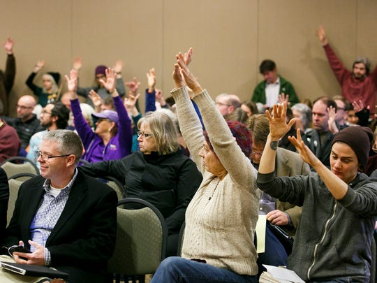 """Audience members silently show their approval as Jane Kwiatkowski of Eugene speaks out against the sale of the Elliott State Forest on Tuesday, Dec. 13, 2016, at the Keizer Community Center. """"Keep this in public hands,"""" said Kwiatkowski. """"Please don't sell this to a private company."""""""