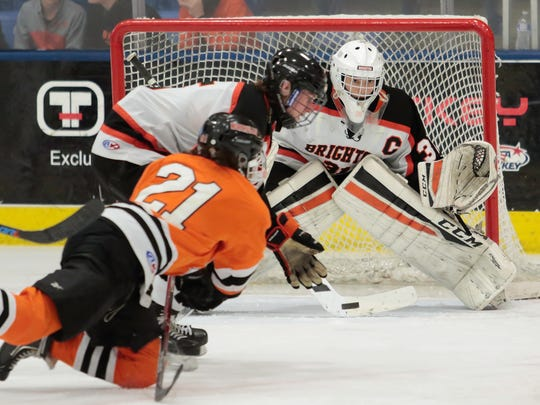 Brighton goalie Logan Neaton, who made 24 saves, follows a shot by Northville's Nick Bonofiglio during the Bulldogs' 5-0 state semifinal victory Friday.