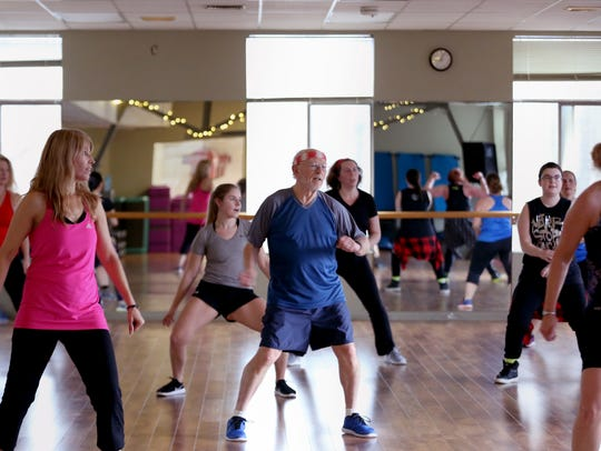 Bob Zakes, 76, center, participates in a Zumba dance