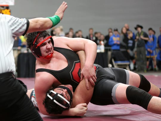 Central's Caleb Sedlacek, top, and Sandy's Iosefa Polamalu compete in the OSAA Wrestling State Championships Class 5A final for weight 285 at Veterans Memorial Coliseum in Portland on Saturday, Feb. 17, 2018. Sedlacek was the champion.