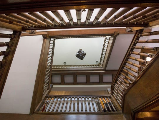 All three floors are connected by a heavy oak staircase
