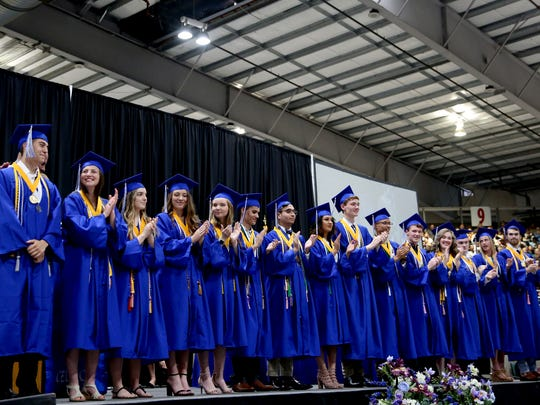 Valedictorians are recognized during the McNary High School commencement at the Oregon State Fairgrounds in Salem on Friday, June 8, 2018.