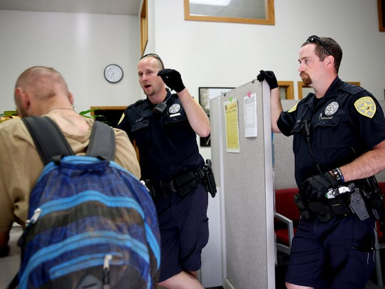 Salem Police Officers Andrew McFerron, right, and David