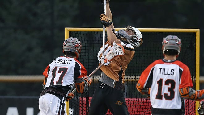John Galloway makes a save during last season. The veteran goalie and the Rattlers will be back playing in downtown Rochester this summer after playing home games at Aquinas and in Brockport.