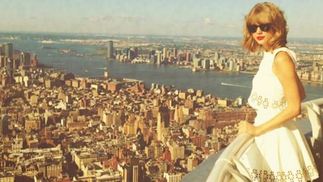 Taylor Swift surveys her kingdom from the Empire State Building. Looks like she made it here.