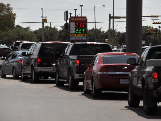 Vehicles line up across the H-E-B parking lot Aug. 31, 2017, to fill up at the grocery store's gas station. H-E-B is ranked fourth nationally, according to a study.
