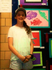 Lainey Shockro was one of the Rehoboth Elementary students to have her artwork on display at the show. Art is one of her favorite classes.