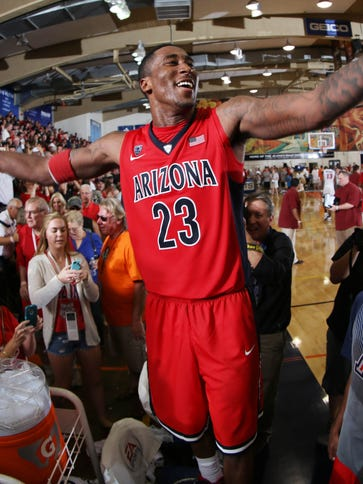 Rondae Hollis-Jefferson celebrates with the fans in