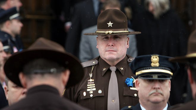 Delaware County Sheriff Mike Scroggins looks on as his uncle's casket is loaded into the hearse. The funeral for Donald Scroggins, 72, former Muncie Police chief and former chief deputy sheriff, was held Monday morning, January 24, 2011, at High Street United Methodist Church in Muncie, Ind.