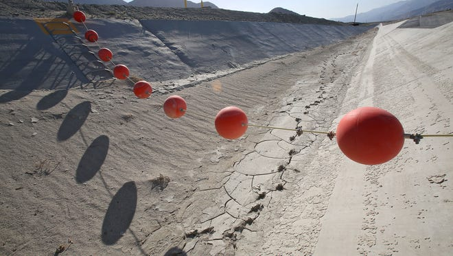 Buoys  hang over a dry canal that leads to the groundwater replenishment ponds on the outskirts of Palm Springs. Less imported water has reached the area during the drought.