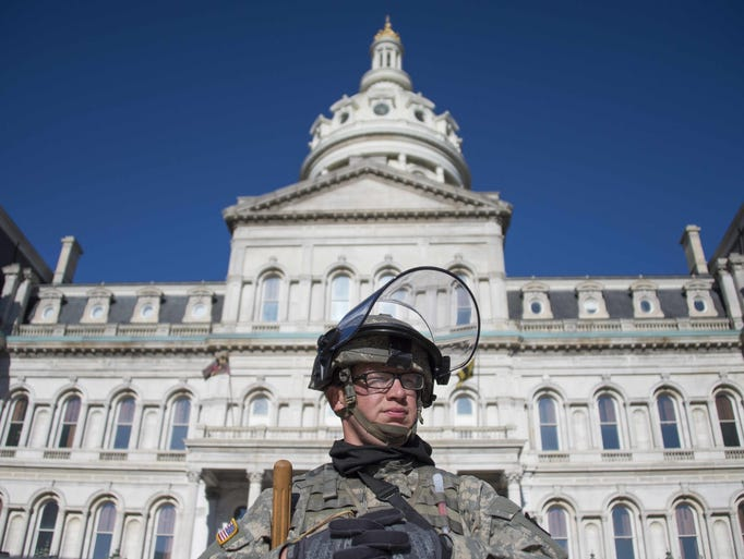 A Maryland National Guard soldier stands guard outside