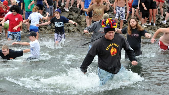 Hundreds took a chilling dip in the tailwaters of the Brookville Reservoir in a New Year's Day Polar Bear plunge in 2011.