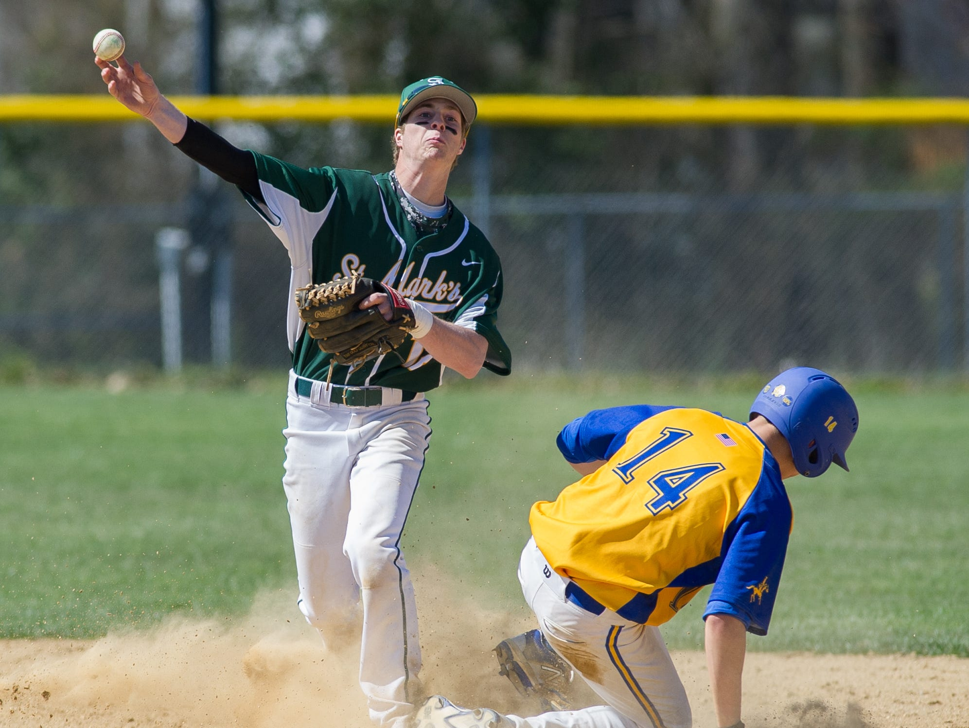 St. Mark's John Panico (12) tags Caesar Rodney's Thomas Pomatto (14) out at second base in the 3rd inning.