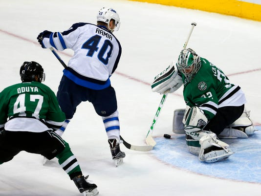 Dallas Stars' Johnny Oduya (47) of Sweden helps goalie Kari Lehtonen (32) of Finland against pressure at the net by Winnipeg Jets' Joel Armia (40) of Finland in the third period of an NHL hockey game, Thursday, Feb. 25, 2016, in Dallas. The Jets won 6-3. (AP Photo/Tony Gutierrez)