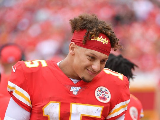 Sep 22, 2019; Kansas City, MO, USA; Kansas City Chiefs quarterback Patrick Mahomes (15) talks to team mates on the bench during the second half abasing the Baltimore Ravens at Arrowhead Stadium. Mandatory Credit: Denny Medley-USA TODAY Sports ORG XMIT: USATSI-403195 ORIG FILE ID:  20190922_ads_sm8_277.JPG