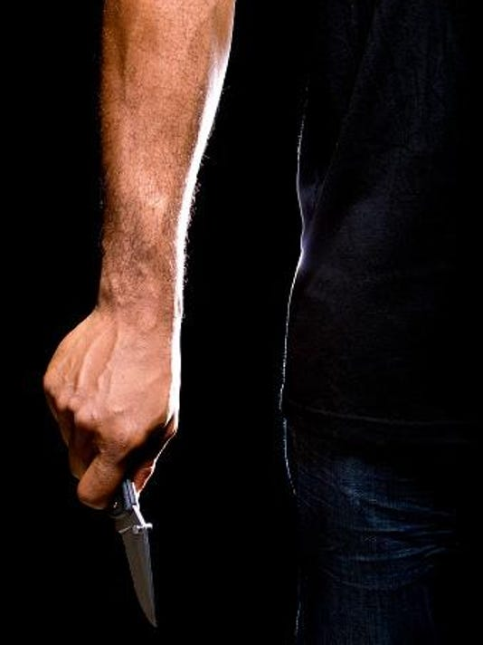 Knife in caucasian hand