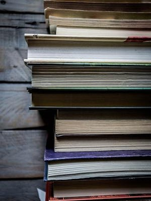 Stack of Books against weathered wood