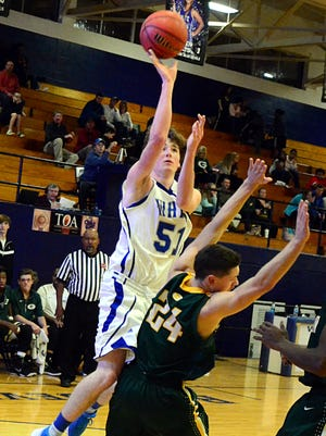 White House High junior Bradley Cole elevates for a first-quarter layin as he draws contact from Gallatin junior Dakota Bailey. Cole scored 28 points in the Blue Devils' 94-83 victory.